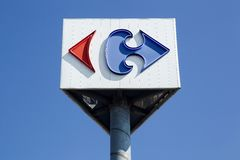 Carrefour sign on a pole. Macon, France - September 21, 2015: Carrefour sign on a pole. Carrefour is a french multinational retailer headquartered in France and Stock Photos