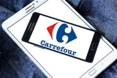 Carrefour stores logo. Logo of the international chain of convenience stores carrefour on samsung mobile phone a5 Royalty Free Stock Photo