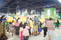 Carrefour supermarket, food area, a lot of people in shopping Stock Image