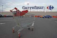 Carrefour supermarket logo and shopping cart stock photography