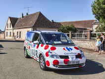 Carrefour Vehicle. Illiers Combray, France, July 21st 2012:  The car of Carrefour driving on the road in a small French village, during the 19th stage- a time Stock Images