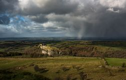 Carreg Cennen castle. Carreg Cennen castle with a winter squall in the background, Carmarthenshire, Wales Royalty Free Stock Photography