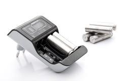 Carregador de bateria com baterias Fotos de Stock Royalty Free