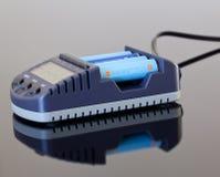 Carregador de bateria do AA Fotografia de Stock Royalty Free