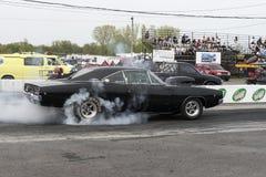 Carregador de Dodge na ação na linha de partida Fotos de Stock Royalty Free