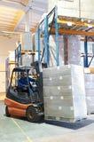 Carregador do Forklift em um armazém Fotografia de Stock Royalty Free