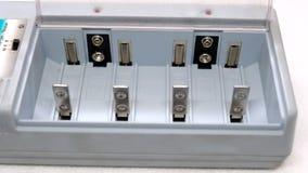 Carregador para tipos diferentes da bateria Fotos de Stock