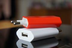 Carregadores coloridos do poder com conectores de USB para um ponto de poder Fotografia de Stock