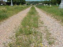 Carreggiate della strada due del cimitero immagini stock