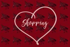 Carrelli con le ombre su rosso con acquisto di parola nel cuore Fotografia Stock Libera da Diritti