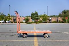 Carrello arancione della base piana Fotografie Stock Libere da Diritti