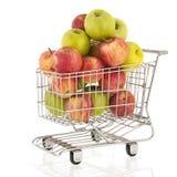 Carrello con le mele verdi e rosse Immagine Stock