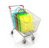 Carrello del supermercato con il sacco di carta colorato ed il controllo fotografia stock