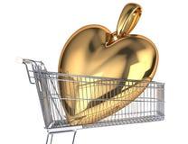 Carrello del supermercato con un pendente molto grande del cuore dell'oro dentro  Immagine Stock