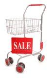 Carrello di acquisto con il segno di vendita Fotografie Stock Libere da Diritti