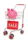 Carrello di acquisto con la banca di vendita di porcellino Immagini Stock
