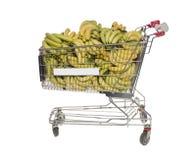 Carrello di acquisto con le banane Fotografia Stock