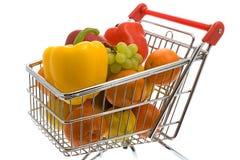 Carrello di acquisto con le frutta e le verdure Fotografia Stock