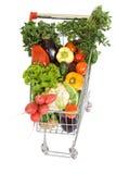 Carrello di acquisto con le verdure immagine stock