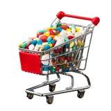 Carrello di acquisto in pieno delle pillole Fotografie Stock Libere da Diritti