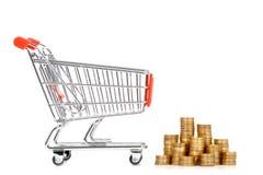Carrello e monete di acquisto Fotografia Stock