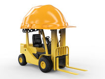 Carrello elevatore a forcale con il casco giallo Fotografia Stock Libera da Diritti