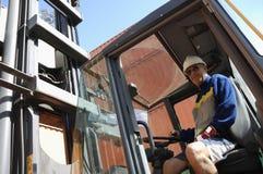 Carrello elevatore a forcale e driver Fotografia Stock