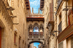 Carrer del Bisbe in Barcelona Gothic quarter, Spain Stock Photos
