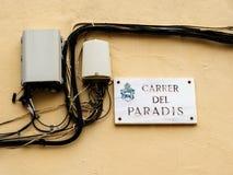 Carrer del Paradis street name plaque with optic fiber hub. On a wall in the city of Inca, Palma de Mallorca, Spain Royalty Free Stock Photos