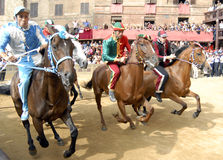 Carrera de caballos del palio de Siena Imagen de archivo libre de regalías
