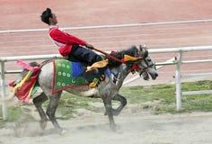 Carrera de caballos tibetana Foto de archivo