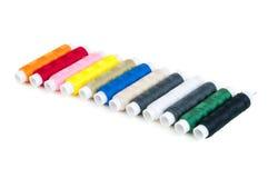 Carretéis coloridos das linhas em seguido Fotografia de Stock