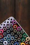 Carretéis das linhas no fundo de madeira Imagem de Stock Royalty Free