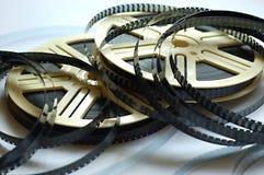 Carretéis de película no fundo branco Fotografia de Stock Royalty Free