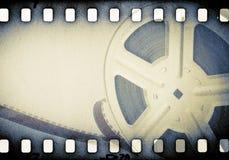 Carrete cinematográfico con la tira de la película Fotos de archivo