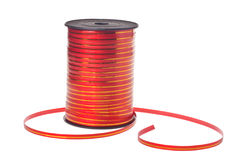 Carrete con la cinta roja decorativa Foto de archivo libre de regalías