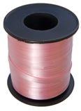 Carrete de la cinta rosada aislado en blanco Fotos de archivo