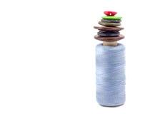 Carrete de la cuerda de rosca y de botones Fotos de archivo libres de regalías