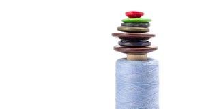 Carrete de la cuerda de rosca y de botones Fotografía de archivo libre de regalías