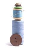 Carrete de la cuerda de rosca y de botones Imagenes de archivo