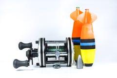 Carrete de la pesca y bobber de la pesca Imagen de archivo
