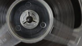 Carrete de la rotación con la cinta, registrador de cinta de audio almacen de video