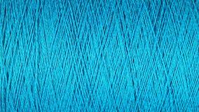 Carrete del fondo azul de la macro del hilo Foto de archivo