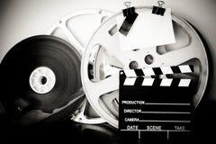 Carrete y chapaleta análogos de la película del vintage Imagenes de archivo