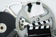 Carrete y chapaleta análogos de la película del vintage Fotografía de archivo libre de regalías