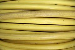 Carretel amarelo da mangueira Imagem de Stock Royalty Free