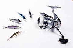 Carretel da pesca com iscas de pesca plásticas Imagem de Stock