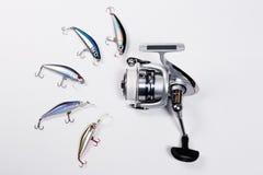 Carretel da pesca com iscas de pesca plásticas Imagem de Stock Royalty Free