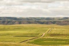 Carretera con curvas en el valle Fotografía de archivo