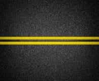 Carretera de asfalto que marca la visión superior Imágenes de archivo libres de regalías
